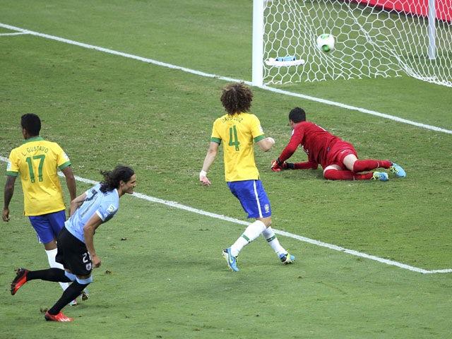 Uruguay's Edinson Cavani celebrates scoring against Brazil during their Confederations Cup semifinal on June 26, 2013