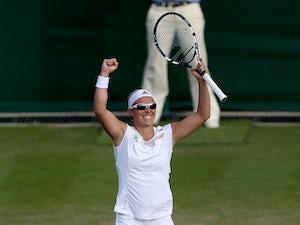 Belgium's Kirsten Flipkens celebrates after victory against Serbia's Bojana Jovanovski during day three of the Wimbledon Championships on June 26, 2013