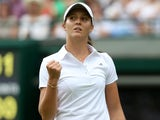 Great Britain's Laura Robson celebrates winning the first set against Russia's Maria Kirilenko on June 25, 2013