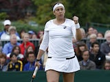 France's Marion Bartoli celebrates during her match against Ukraine's Elina Svitolina during day one of Wimbledon on June 24, 2013