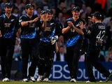New Zealand players celebrate after taking the wicket of England's Eoin Morgan during their International Twenty20 match on June 25, 2013
