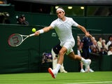 Roger Federer plays a shot against Victor Hanescu during the first round of Wimbledon on June 24, 2013