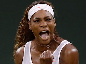 Serena Williams reacts after winning a point against Kimiko Date-Krumm during their Wimbledon match on June 29, 2013
