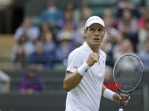 Tomas Berdych of the Czech Republic reacts after winning a point against Martin Klizan of Slovakia during their Men's first round singles match on June 25, 2013