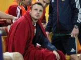 British and Irish Lions' Tommy Bowe sits injured on the bench during the match against Queensland Reds on June 8, 2013