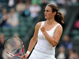 Serbia's Vesna Dolonc celebrates after defeating compatriot Jelena Jankovic in the second round of the Wimbledon Tennis Championships on June 26, 2013