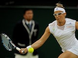 Kirsten Flipkens returns the ball to opponent Petra Kvitova during their Wimbledon quarter final match on July 2, 2013