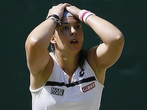 Marion Bartoli reacts to winning Wimbledon on July 6, 2013