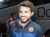 Barcelona's Cesc Fabregas steps off the team bus on July 15, 2013