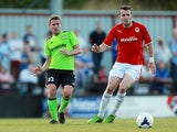 Forest Green Rovers Anthony Barry and Cardiff City's Jordon Mutch battle for the ball during a friendly match on July 24, 2013
