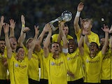 Dortmund's Sebastian Kehl raises the trophy after winning the German Super cup on July 26, 2013