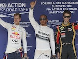 Lewis Hamilton, Sebastian Vettel and Romain Grosjean wave following qualifying for the Hungarian GP on July 27, 2013
