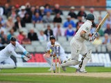Australia's Chris Rogers is caught behind by England's Matt Prior during day four of the Third Ashes Test on August 4, 2013