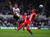 Derby's Jeff Hendrick and Blackburn Alex Marrow battle for the ball on August 4, 2013