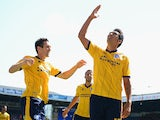 Brighton's Leonardo Ulloa celebrates moments after scoring the opening goal against Leeds on August 3, 2013