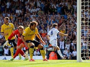 Leed's Luke Murphy celebrates moments after scoring the winner against Brighton on August 3, 2013