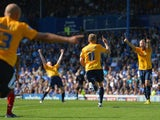 Alfie Potter of Oxford celebrates after scoring his side's third goal during the Sky Bet League Two match between Portsmouth and Oxford United on August 3, 2013