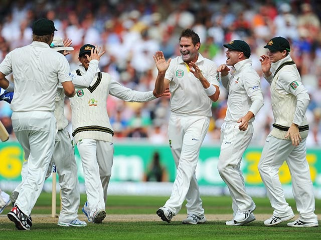 Australia's Ryan Harris celebrates with team mates after taking the wicket of England's Jonathan Trott during the third day of the 3rd Ashes Test on August 3, 2013
