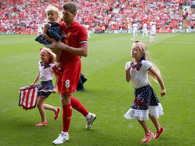 Steven Gerrard of Liverpool walks his three daughters of the pitch prior to the Steven Gerrard Testimonial Match on August 3, 2013