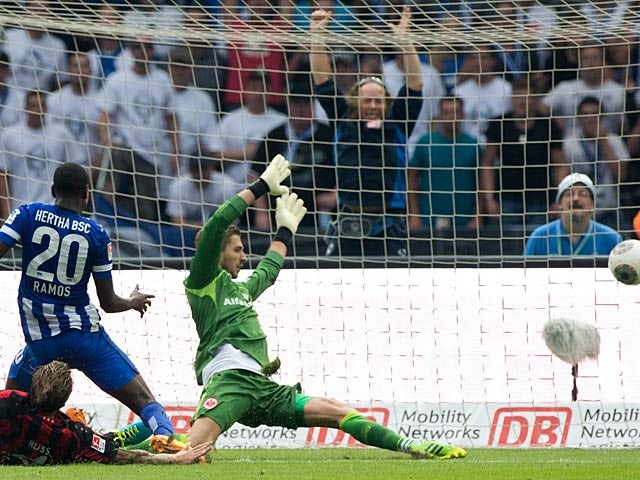 Hertha Berlin's Adrian Ramos scores the opening goal against Eintracht Frankfurt on August 10, 2013