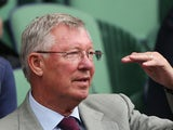 Sir Alex Ferguson watches the Gentlemen's Singles quarter-final match between Andy Murray of Great Britain and Fernando Verdasco of Spain on day nine of the Wimbledon Lawn Tennis Championships on July 3, 2013