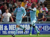 Coventry's Billy Daniels is congratulated by team mate Franck Moussa after scoring the winning goal against Bristol City on August 11, 2013