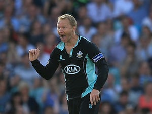 Surrey's Gareth Batty celebrates after taking the wicket of Kent's Samuel Billings during the T20 match on July 26, 2013