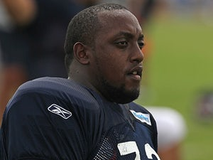 Chicago Bears' J'Marcus Webb rests during summer training camp on August 6, 2011