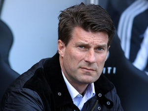 Swansea City's Danish manager Michael Laudrup takes his seat in the dugout prior to the English Premier League football match between Swansea City and Southampton on April 20, 2013