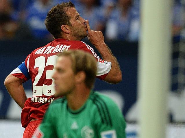 Hamburg's Rafael van der Vaart celebrates after scoring the equaliser against Schalke on August 11, 2013
