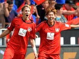 Leverkusen's Stefan Kiessling is congratulated by team mate Heung Min Son after scoring against Freiburg on August 10, 2013