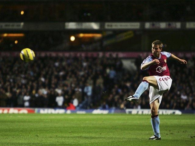 Thomas Hitzlsperger shoots for goal against Tottenham Hotspur.