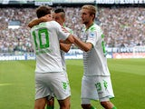 Moenchengladbach's striker Max Kruse and his teammates celebrate scoring during the German first division Bundesliga football match Borussia Moenchengladbach vs Hanover 96 in the German city of Moenchengladbach on August 17, 2013.