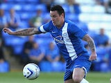 Lee Tomlin of Peterborough United runs with the ball during the pre season friendly match between Peterborough United and Hull City at London Road Stadium on July 29, 2013