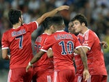 Lyon's French midfielder Yoann Gourcuff celebrates with teammates after scoring a goal during the French L1 football match agaisnt Sochaux on August 16, 2013