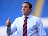 Cardiff City manager Malky Mackay shouts instructions to his team during the Cardiff City v Chievo Verona Pre Season Friendly game at the Cardiff City Stadium on August 3, 2013