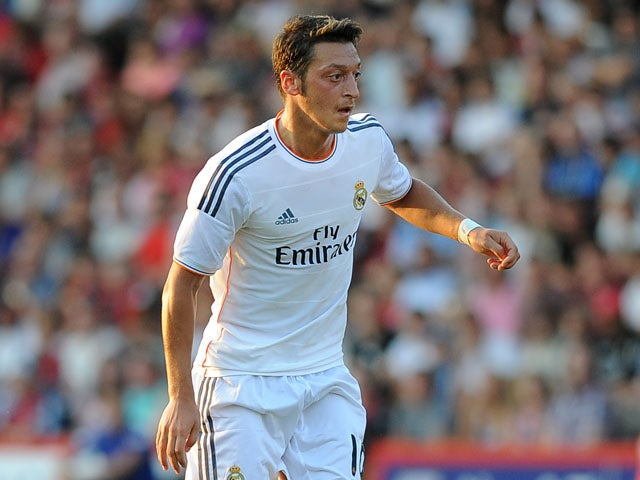 Mesut Ozil of Real Madrid attacks during the pre season friendly match between Bournemouth and Real Madrid at Goldsands Stadium on July 21, 2013