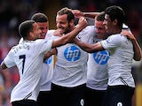 Spurs' Roberto Soldado is congratulated by team mates after scoring the opening goal against Crystal Palace on August 18, 2013