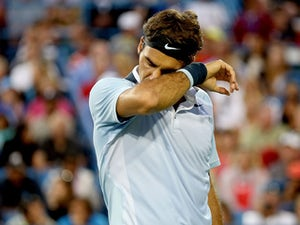 Federer breaks ties with coach
