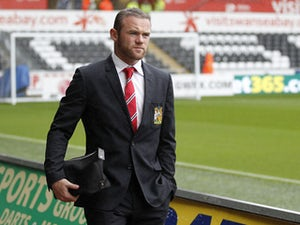 Manchester United's English striker Wayne Rooney arrives at the Liberty stadium for the English Premier League football match between Swansea City and Manchester United at Liberty Stadium in Swansea, south Wales, on August 17, 2013