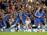 Branislav Ivanovic of Chelsea is congratulated by teammates after scoring his team's second goal during the Barclays Premier League match between Chelsea and Aston Villa at Stamford Bridge on August 21, 2013