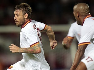 Roma's Daniele De Rossi celebrates a goal against Livorno on August 25, 2013