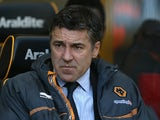 Then Wolves boss Dean Saunders, sitting in the dugout on April 16, 2013