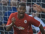 Cardiff striker Frazier Campbell wheels away to celebrate his goal against Man City on August 25, 2013