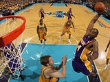 Los Angeles Lakers star Kobe Bryant rises high to dunk against the New Orleans Pelicans on April 22, 2011