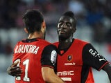 Rennes' Nelson Oliveira is congratulated following a goal against Evian on August 24, 2013