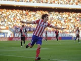 Atletico's Tiago Mendes celebrates a goal against Rayo on August 25, 2013