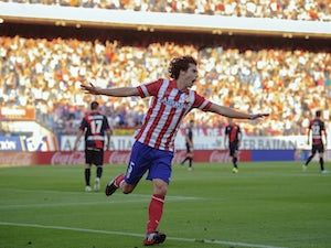 Tiago delighted with Atletico stay