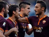 Roma's Adem Ljajic is congratulated by team mates after scoring his team's third goal against Hellas Verona on September 1, 2013