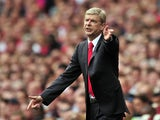 Arsenal's French manager Arsene Wenger gestures during the English Premier League football match between Arsenal and Tottenham Hotspur at the Emirates Stadium in London on September 1, 2013